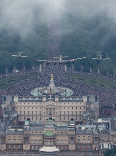 LONDON, ENGLAND - JUNE 14: A Lancaster is flanked by two Spitfires of the Battle of Britain Memorial Flight fly over Buckingham Palace as part of Her Majesty The Queen's Birthday Flypast during Trooping the Colour on June 14, 2014 in London, England. (Photo by Matt Cardy/Getty Images)
