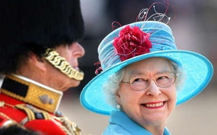 Trooping the Colour...Britain's Queen Elizabeth II smiles with the Duke of Edinburgh on Horse Guards Parade during the annual Trooping the Colour parade. PRESS ASSOCIATION Photo. Picture date: Saturday June 13, 2009. The Queen celebrates her official birthday today with the Trooping the Colour parade involving more than 1,000 soldiers in the traditional display of pomp and pageantry. See PA story ROYAL Trooping. Photo credit should read: Lewis Whyld/PA Wire